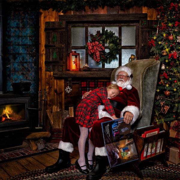 little girl whispering in Santa's ear