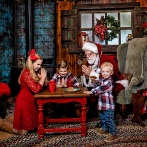 Children with Santa saying Prayers